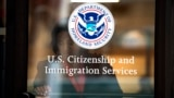 FILE - A woman leaves the U.S. Citizenship and Immigration Services offices in New York, Aug. 15, 2012.