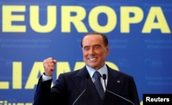 FILE - Forza Italia leader Silvio Berlusconi gestures during EPP European People's Party meeting in Fiuggi, Italy, Sept. 17, 2017.