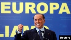 FILE - Silvio Berlusconi, seen in this Sept. 2017 file photo, is the three-time Italian premier who has made a career out of rebounding from legal woes, personal scandal, heart trouble and political setbacks. He is running for the European Parliament in May elections.