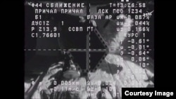 Video de una cámara en la nave Progress 62 muestra el objetivo del acomplamiento en la Estación Espacial Internacional. Imagen cortesía NASA.