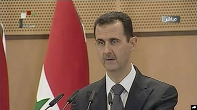 Syria's President Bashar al-Assad speaks in Damascus in this still image taken from video, June 20, 2011