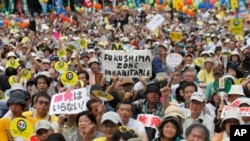 Organizers say 60,000 participated, in their largest protest since the mid-March nuclear plant accident at Fukushima, September 19, 2011.