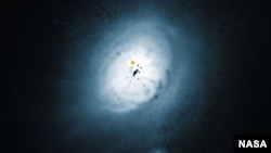 NASA/ESA Hubble Space Telescope view of the dust disc around the young star HD 100546. (ESO/NASA/ESA/Ardila et al.)