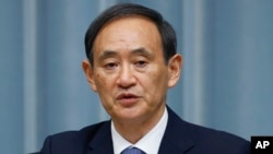 FILE - Japan's Chief Cabinet Secretary Yoshihide Suga.