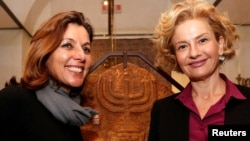 Vatican Museums Director Barbara Jatta, left, and Head of Rome's Jewish Museum Alessandra Di Castro shown during a news conference where they presented an exhibition on the menorah, the ancient symbol of Judaism, at the Jewish Museum in Rome, Feb. 20, 2017.