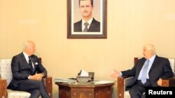 Syrian Foreign Minister Walid al-Muallem (R) meets with U.N. special envoy for Syria Staffan de Mistura in Damascus, Syria, in this handout picture provided by SANA, Nov. 20, 2016.