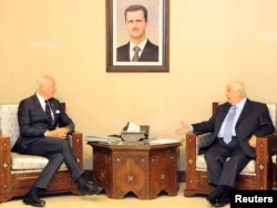FILE - Syrian Foreign Minister Walid al-Muallem meets with U.N. mediator for Syria Staffan de Mistura in Damascus, Syria, in this handout picture provided by SANA, Nov. 20, 2016.