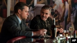 "Image released by Columbia Pictures shows Matt Damon, left, and George Clooney in ""The Monuments Men."""