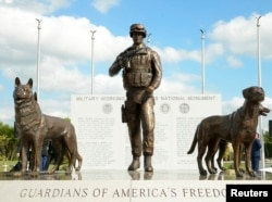 FILE - A U.S. Military Working Dog Teams National Monument is unveiled at Joint Base San Antonio-Lackland, in San Antonio, Oct. 28, 2013. Two people were killed in a shooting at the base Friday.