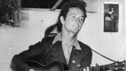 "American Folk Singer Woody Guthrie. ""This Land is Your Land"" became most famous song."