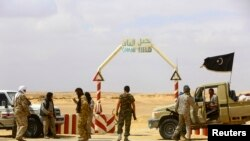 FILE - The entrance to the al-Ghani oil field, south of Ras Lanuf, Libya, formerly under rebel control, Mar. 18, 2014.