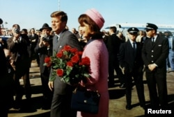 FILE - President John F. Kennedy and first lady Jacqueline Bouvier Kennedy arrive at Love Field in Dallas, Texas, Nov. 22, 1963.