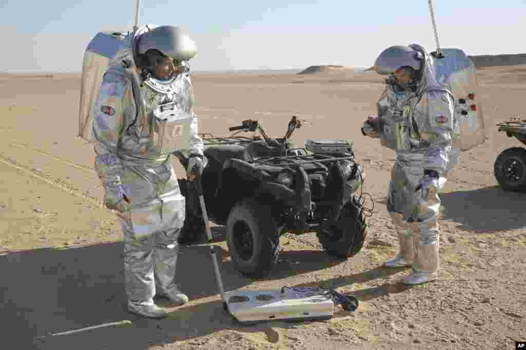 Two scientists test space suits and a geo-radar for use in a future Mars mission in the Dhofar desert of southern Oman. The desolate desert in southern Oman resembles Mars so much that more than 200 scientists from 25 nations organized by the Austrian Space Forum are using it for the next four weeks to field-test technology for a manned mission to Mars.