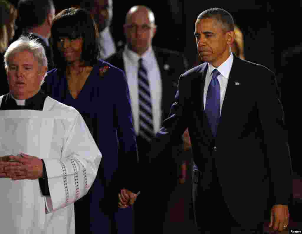 U.S. President Barack Obama and First Lady Michelle Obama arrive for an inter-faith memorial service for the victims of the bombing at the Boston Marathon in Boston, April 18, 2013.