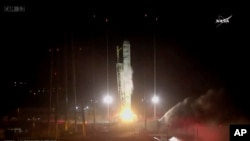 In this photo made from NASA video, the Orbital/ATK Cygnus CRS-9 sits on top of an Antares rocket as it launches from NASA's Wallops Flight Facility, May 21, 2018, in Virginia.