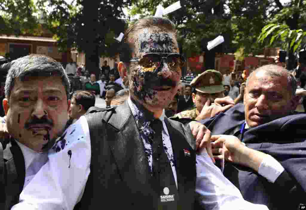 Chairman of Sahara India Pariwar Subrata Roy, whose face smeared with ink thrown by a lawyer, walks into the Supreme Court in New Delhi. The top Indian businessman faces charges of failure to return billions of dollars to investors. Roy's Sahara conglomerate is well known throughout India because it co-owns a Formula One team and sponsored the Indian cricket team until recently.