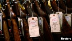 Shotguns are seen during the East Coast Fine Arms Show in Stamford, Connecticut, Jan. 5, 2013.