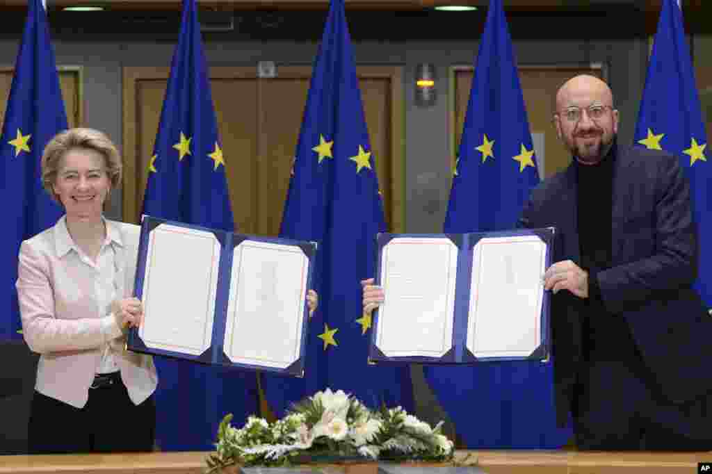 European Commission President Ursula von der Leyen, left, and European Council President Charles Michel show signed EU-UK Trade and Cooperation Agreement at the European Council headquarters in Brussels, Belgium.