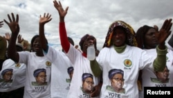 Members of the Zimbabwe People First welcoming their president.