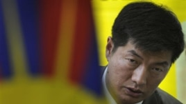 Newly elected head of the Tibetan government-in-exile Lobsang Sangay talks to the media after meeting with Tibetan activists on a hunger strike against blockade of the Kirti monastery in Sichuan province by Chinese forces, in New Delhi, India, Thursday, M