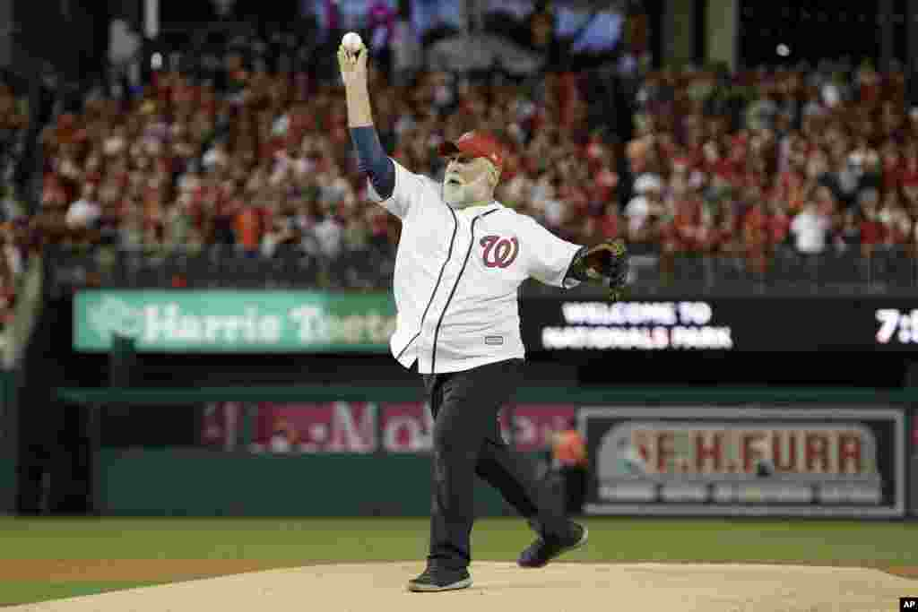 Chef Jose Andres throws out the first pitch before Game 5 of the baseball World Series between the Houston Astros and the Washington Nationals Sunday, Oct. 27, 2019, in Washington, D.C.