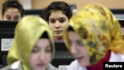 Turkish girls attend computer lessons at Kazim Karabekir Girls' Imam-Hatip School, Istanbul, February 10, 2010.