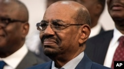 FILE - Sudanese President Omar al-Bashir smiles during a visit to Johannesburg, South Africa, June 14, 2015.