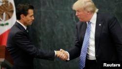 Le candidat républicain à la Maison Blanche Donald Trump et le président mexicain Enrique Peña Nieto, lors d'une conférence de presse à Mexico, Mexique, le 31 août 2016.