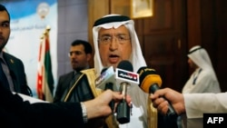 FILE - Saudi Arabia's Minister of Electricity and Water Abdullah al-Hussayen speaking to the press in Kuwait City. King Salman has sacked Hussayen amid public anger over price hikes, state media reported on April 24, 2016.