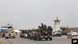 Iraqi security forces and Shi'ite militiamen prepare to attack Islamic State extremists in Tikrit, 130 kilometers (80 miles) north of Baghdad, March 13, 2015.