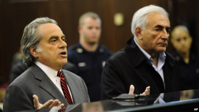 Dominique Strauss-Kahn, head of the International Monetary Fund, right, with his attorney Benjamin Brafman, is arraigned Monday, May 16, 2011, at Manhattan Criminal Court in New York.