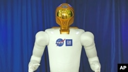 A photo of the first human-like robot - Robonaut 2, or R2 - on the International Space Station to make its operational debut on the orbiting lab.