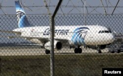 FILE - An Egyptair Airbus A320 airbus stands on the runway at Larnaca Airport in Larnaca, Cyprus.