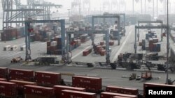 FILE - Containers are pictured at the ITS terminal at the Port of Long Beach, Calif., Dec 4, 2012.