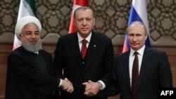 Хасан Роухани, Реджеп Тайип Эрдоган и Владимир Путин после совместной пресс-конференции в рамках трехстороннего саммита по Сирии, в Анкаре, 4 апреля 2018 года