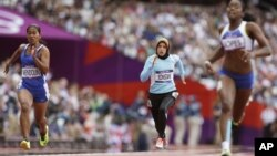 Afghanistan's Tahmina Kohistani competes in a women's 100-meter heat during the athletics in the Olympic Stadium at the 2012 Summer Olympics, London, August 3, 2012.