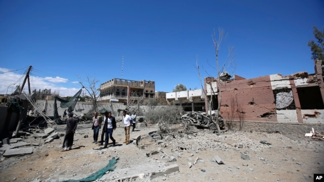 Yemeni people inspect the damage after an airstrike by Saudi-led coalition in Sana'a, Yemen, Feb. 27, 2016.