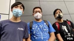 香港民間團體天水連線成員林進(左起)、守護大嶼聯盟成員謝世傑與社民連陳寶瑩6月25日向警方申請舉辦7-1遊行。 (美國之音湯惠芸)