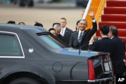 U.S. President Barack Obama waves upon his arrival at the Tan Son Nhat International Airport in Ho Chi Minh City, Vietnam during his three-day visit to the country.