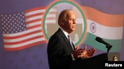 U.S. Vice President Joe Biden delivers an address at the Bombay Stock Exchange (BSE) in Mumbai July 24, 2013.