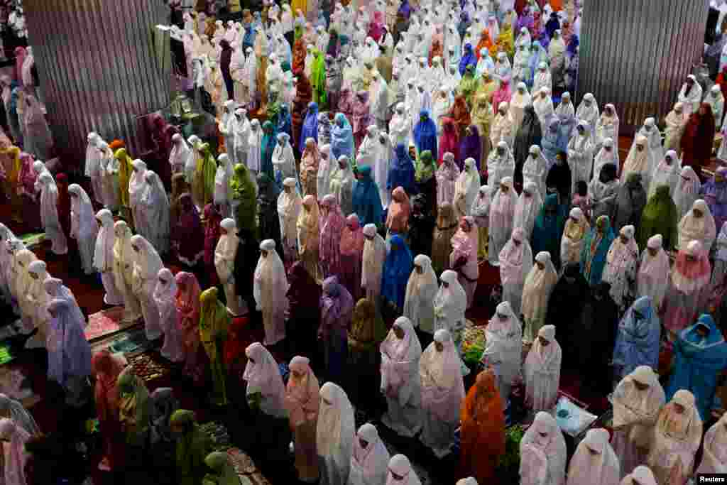 Muslim women attend Ramadan tarawih prayer at Istiqlal mosque in Jakarta, Indonesia.