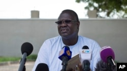 FILE - A July 26, 2013 photo shows former South Sudan VP Riek Machar speaking to the media to announce he will run for the presidency in 2015 against President Salva Kiir.