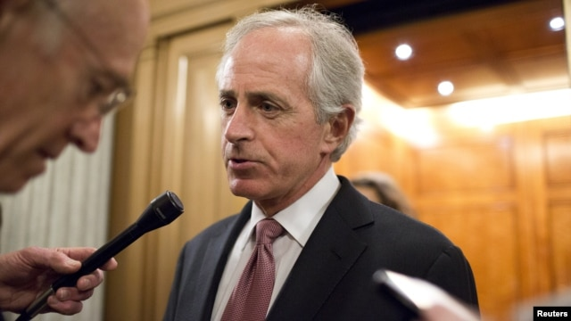 Senator Bob Corker (R-TN) speaks with reporters after a vote on Capitol Hill in Washington December 17, 2012.