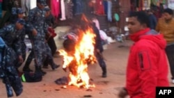 An exiled Tibetan monk sets himself on fire at Boudhanath Stupa in Kathmandu, February 13, 2013.