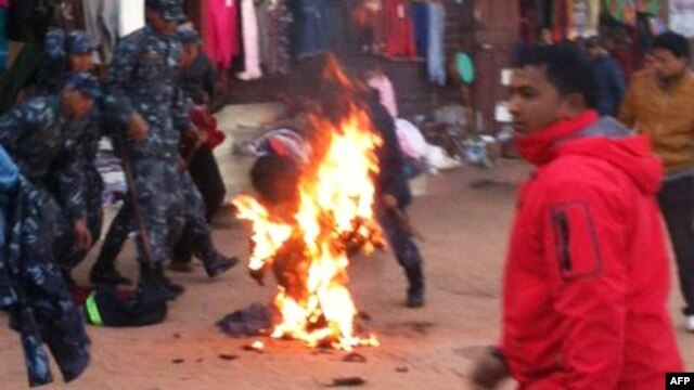 An exiled Tibetan monk sets himself on fire at Boudhanath Stupa in Kathmandu, February 13, 2013.