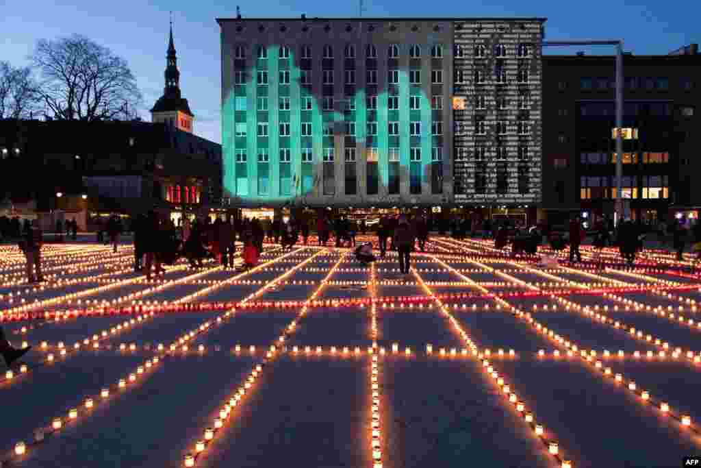 Thousands of candles are lit in Tallinn, Estonia to commemorate the tens of thousands of victims of the deportation march when, from March 25-28, 1949, more than 22,000 people in Estonia alone were forced from their homes and deported east, many to never return.