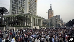 Hundreds of Egyptian Christians march in front of Egyptian Foreign Ministry building, left, and Television building tower, in Cairo, Egypt, Jan 2, 2011