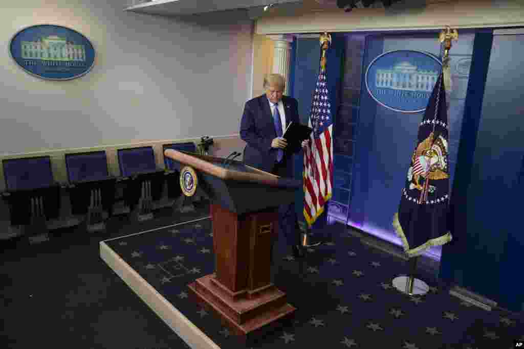 President Donald Trump arrives for a news conference at the White House, Wednesday, July 22, 2020, in Washington. (AP Photo/Evan Vucci)