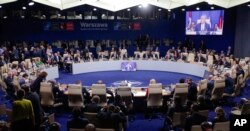 State leaders attend a working session at the NATO summit in Warsaw, Poland, Saturday, July 9, 2016.
