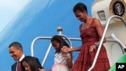 US President Barack Obama with first lady Michelle Obama and daughters Malia and Sasha during their airport arrival at Brasilia Air Base in Brasilia, Brazil, Saturday, March 19, 2011. (AP Photo/Pablo Martinez Monsivais)